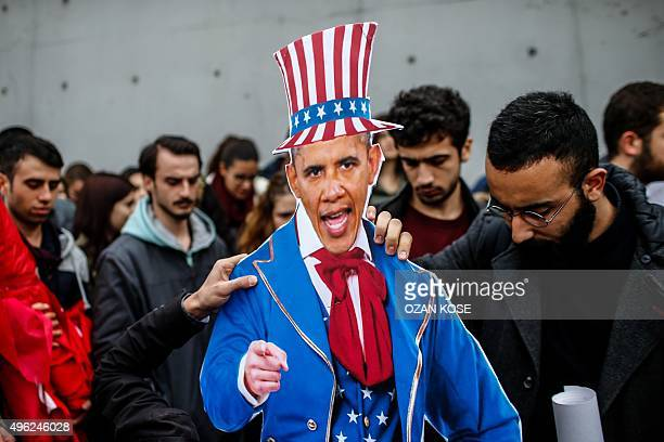 Members of Turkey's Youth Union hold an effigy representing US President Barak Obama portrayed as Uncle Sam on November 8 2015 near the US consulate...