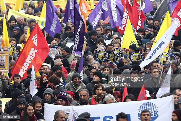 Members of Turkish civil servant unions walk to protest against the government's economy policies and ask for an increase in wages on December 19...