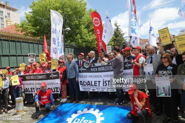 """Members of Turkish labor unions hold a banner reading """"We want justice"""" as they take part in a protest on May 13, 2019 in Ankara in memory of miners..."""
