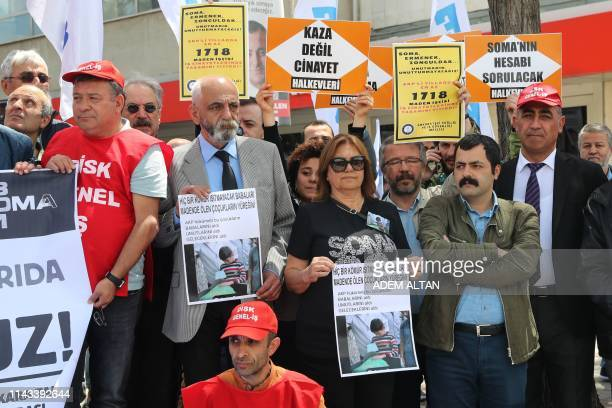 Members of Turkish labor unions hold signs as they take part in a protest on May 13, 2019 in Ankara in memory of miners who died five years ago in an...