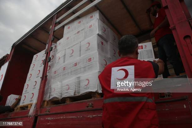 Members of Turkish Red Crescent distribute humanitarian aids to the civilians in Tal Abyad Syria after the city center was cleared from PKK listed as...