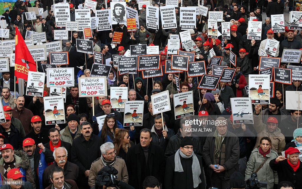 Members of Turkish unions stage a protest against the deployment of patriot missiles by NATO in Turkey on January 20, 2013 In Ankara. The banner reads: 'No to Patriots ' , 'No to imperialist intervention in Syria'.