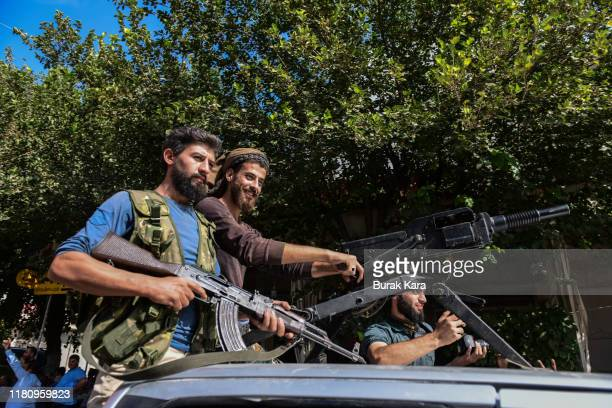 Members of Turkishbacked Free Syrian Army a militant group active in parts of northwest Syria heading toward Syrian town of Tal Abyad on October 14...