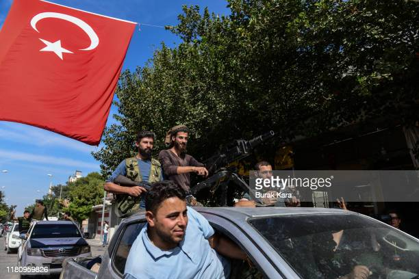 Members of Turkish-backed Free Syrian Army, a militant group active in parts of northwest Syria, heading toward Syrian town of Tal Abyad on October...