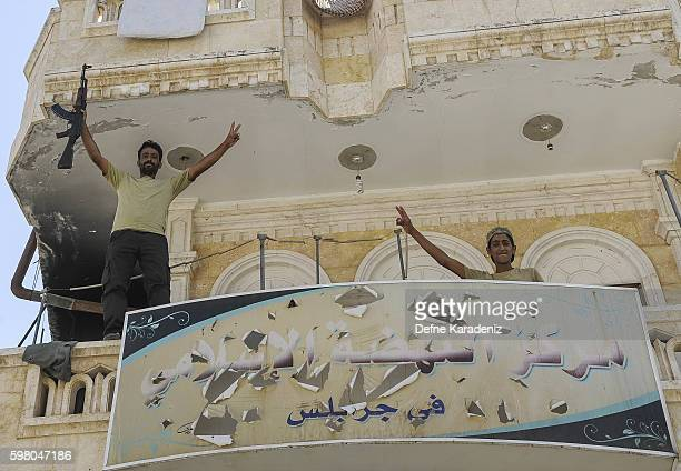Members of Turkishbacked Free Syrian Army are pictured as they look out from a building in the border town of Jarablus August 31 Syria Turkish troops...