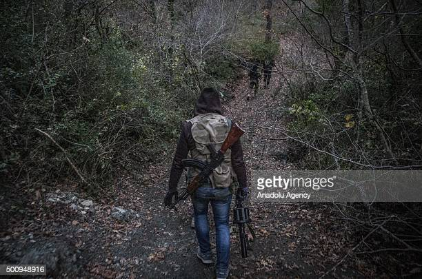 Members of Turkmen Brigades are seen as they fight to regain the control of Kizildag which is the most important region in the area in the Bayirbucak...