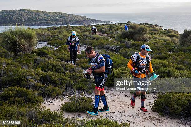 Members of two teams trying to find the route along the coast to Checkpoint 3 during the Adventure Race World Championship on November 11 2016 in...