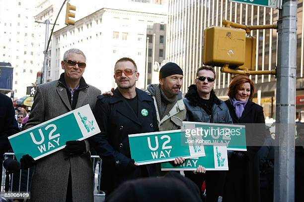 Members of U2 Adam Clayton Bono The Edge and Larry Mullen Jr and Christine Quinn of City Council attend the rename of West 53rd Street U2 Way on...