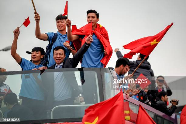 Members of U23 Vietnam football team greet fans in front of Noi Bai Airport after returning from 2018 Asian Football Confederation's championship on...