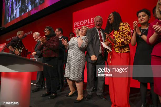 Members of UK opposition Labour party's shadow cabinet react after leader Jeremy Corbyn delivered his keynote speech on day three of the annual...