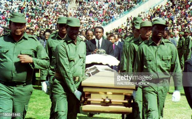 Members of UmkhontoWesizwe the African National Congress' military wing carry the coffin of the assassinated South African Communist Party leader...