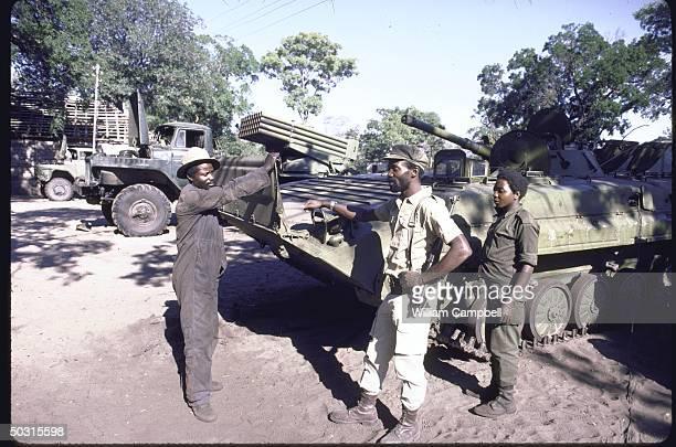 Members of UNITA rebel troops standing beside a vehicle at UNITA headquarters