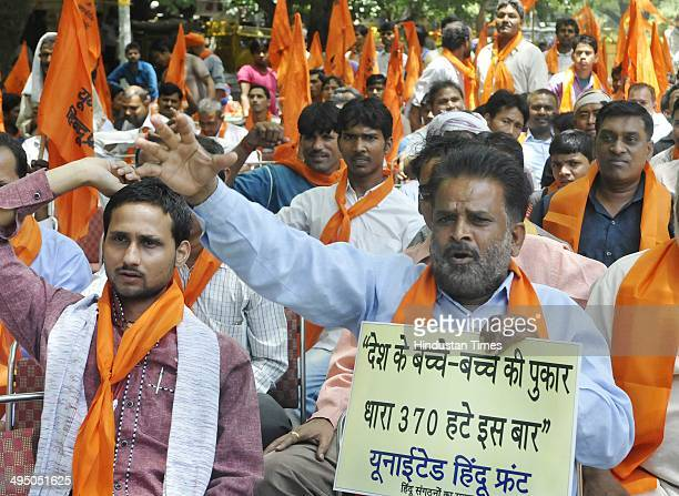 Members of United Hindu Front and others protest against to remove article 370 and chief minister of Jammu and Kashmir Omar Abdullaha against his...