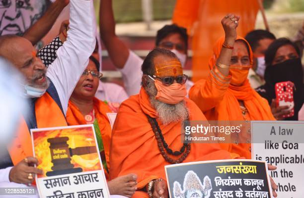 Members of United Hindu Front hold placards and raise slogans during a protest demanding a population control law to be implemented in India owing to...