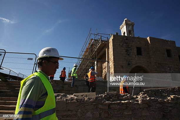 Members of United Nations and the restoration team walk around the Apostolos Andreas Monastery in North Cyprus at Rizokarpaso a town in the Karpass...