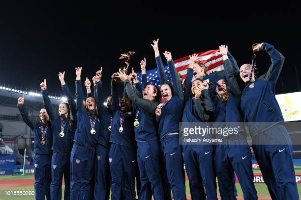 Members of United States celebrate winning the gold medal on day eleven of the WBSC Women's Softball World Championship on August 12 2018 in Chiba...