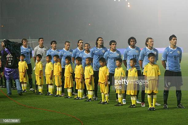 Members of Uruguay national team sing the national anthem during an international friendly football match between Uruguay and China at Wuhan Sports...