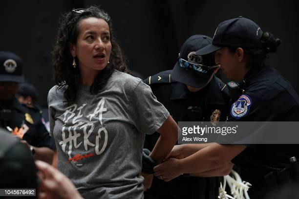 Members of U.S. Capitol Police arrest a demonstrator during a protest October 4, 2018 at the Hart Senate Office Building on Capitol Hill in...