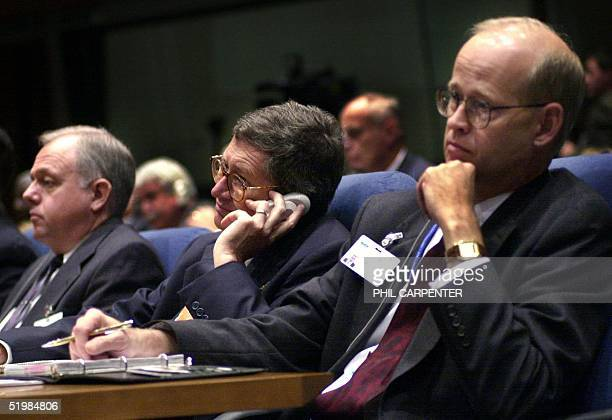 Members of US delegation Mike O'Neill Don Koran and Frank Price listen during the opening ceremony of the 33rd session of the International Civil...