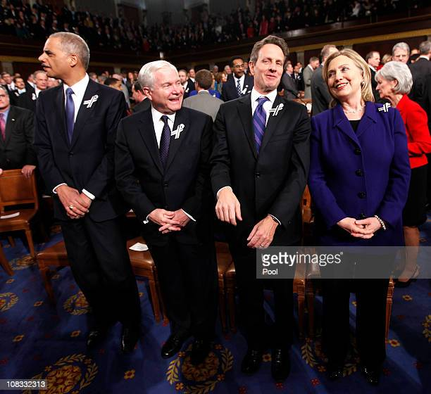 Members of US President Barack Obama's Cabinet Attorney General Eric Holder Defense Secretary Robert Gates Treasury Secretary Timothy Geithner and...