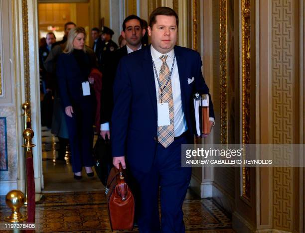 Members of US President Donald Trumps legal team arrive before the start of the impeachment trial against US President Donald Trump on January 29,...