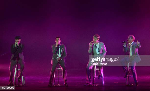 Members of US vocal group Backstreet Boys , Alexander James McLean, Howard Dwaine Dorough, Nickolas Gene Carter, Brian Littrell, perform at a concert...