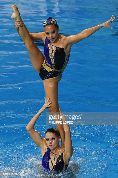 Members of Uzbekistan's team execute a move in the team free routine final synchronised swimming event during the 2014 Asian Games at the Munhak Park...