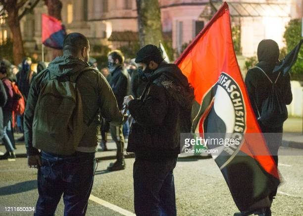 Members of various AntiFascist Antifa groups rallying in protest outside the Greek Embassy under the banner of Migrant Solidarity in response to...