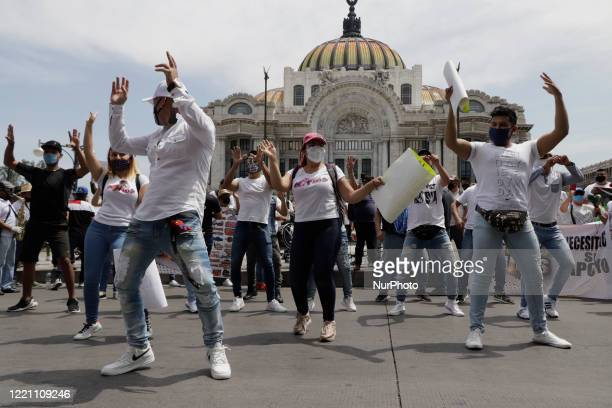 Members of various musical groups of the grupero and cumbia genre marched and danced from the Monument to the Revolution and Palace of Fine Arts to...