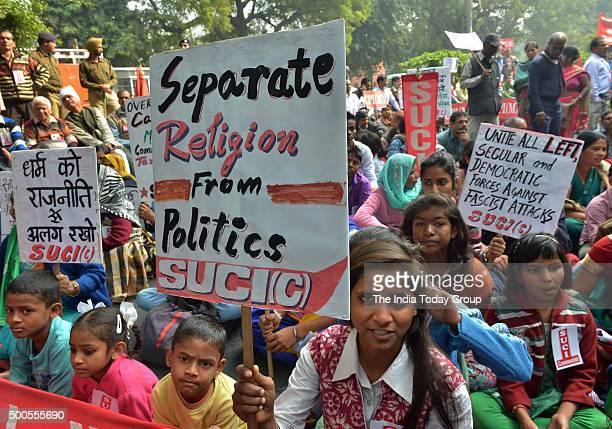 Members of various organisation during protest on the anniversary of Babri Masjid demolition at Jantar Mantar in New Delhi