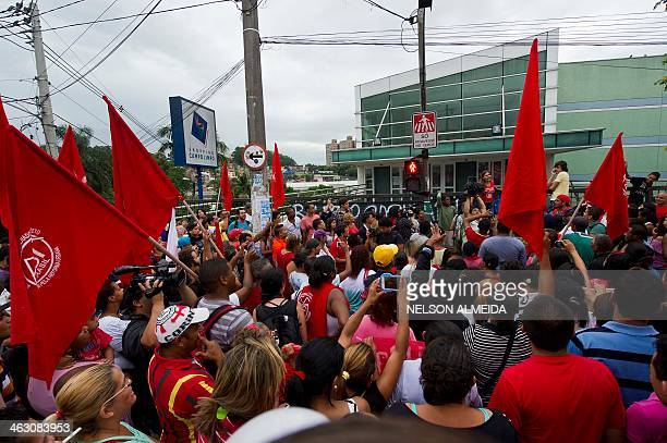 Members of various social movements protest in fron of the Campo Limpo shopping mall in Sao Paulo Brazil on January 16 2014 against the injunction...
