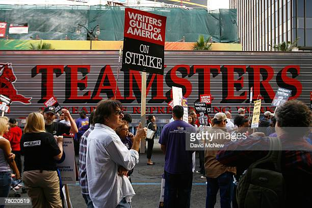 Members of various unions including the Teamsters Service Employees International Union and California Nurses Association march in solidarity with...