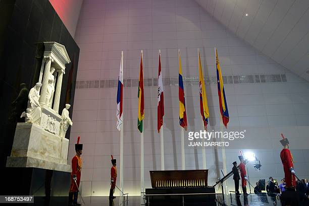 Members of Venezuelan Honor Guard stand by the coffin of South American independence hero Simon Bolivar during a ceremony of the new mausoleum in...