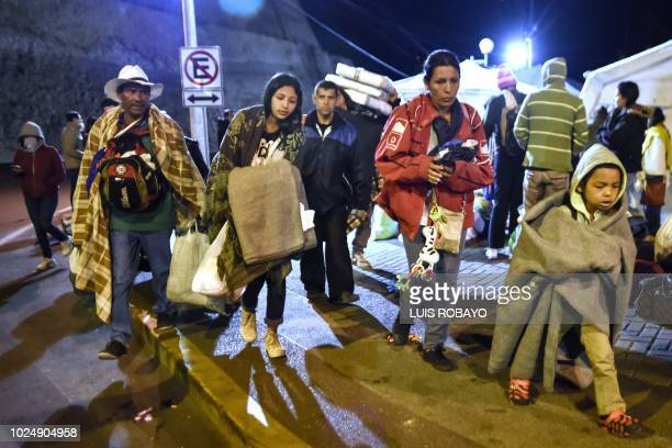 Members of Venezuelan migrant family Mendoza Landinez wait for the buses provided by Ecuadoran authorities to take them to the border with Peru...