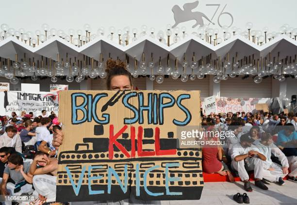 TOPSHOT Members of Venice's No Big Ships Committee and people stage a protest against the cruise ships that sail in the Venice lagoon and against the...