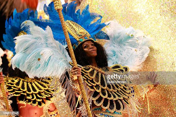 Members of Vila Isabel dance during the samba school's parade at Rio de Janeiro's carnival on on March 06 2011 in Rio de Janeiro Brazil Carnival is...
