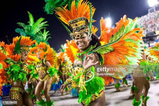 Members of Vila Isabel samba school perform during its parade at 2014 Brazilian Carnival at Sapucai Sambadrome on March 03, 2014 in Rio de Janeiro,...