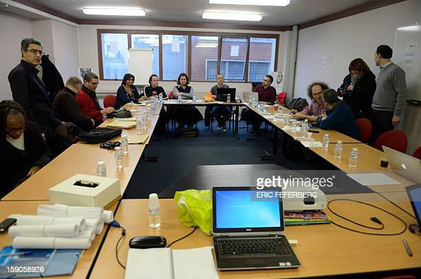 Members of Virgin Megastore's works council wait prior to hold a extraordinary board meeting on January 7 2013 in Paris as the chain which currently...
