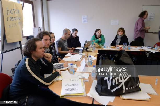 Members of Virgin Megastore's works council wait prior to hold a extraordinary board meeting, on January 7, 2013 in Paris, as the chain, which...