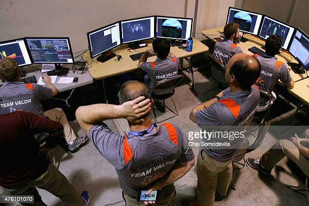 Members of Virginia Tech's Team Valor sit at the computers where they wirelessly control their semiautonomous ESCHER robot during the second day of...