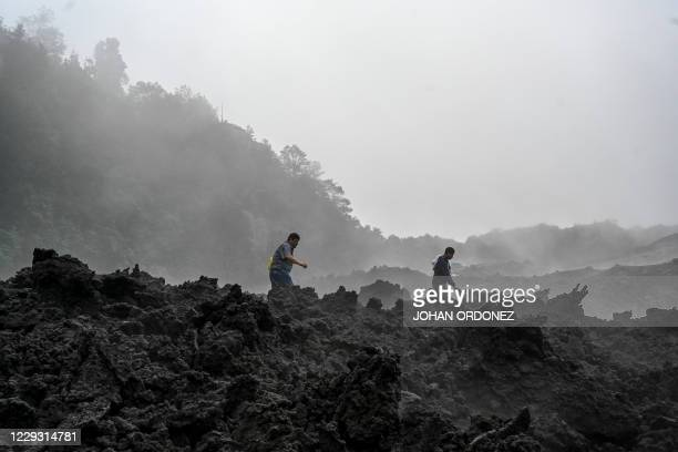 Members of Volcan Pacaya National Park walk the Pacaya volcano area in Cerro Chino in San Vicente Pacaya municipality, about 55 km south of Guatemala...