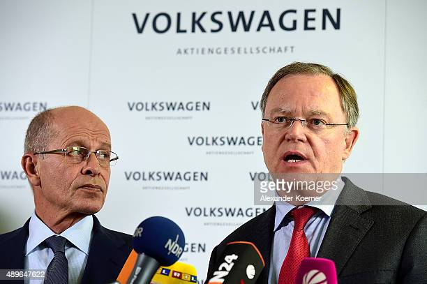 Members of Volkswagen's Supervisory board Berthold Huber and Stephan Weil inform waiting journalists about the decision of Martin Winterkorn to...