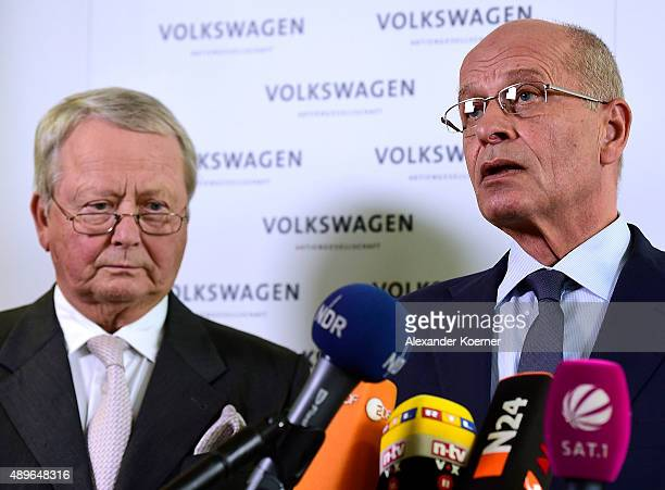 Members of Volkswagen's Supervisory board Wolfgang Porsche and Berthold Huber inform waiting journalists about the decision of Martin Winterkorn to...