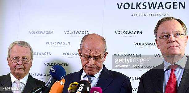 Members of Volkswagen's Supervisory board Wolfgang Porsche, Berthold Huber and Stephan Weil inform waiting journalists about the decision of Martin...