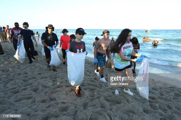 Members of VolunteerCleanUporg collect discarded plastic bottles and cups as thousands of college students and nonstudents attend Spring Break...