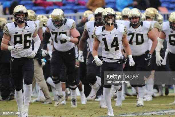 Members of Wake Forest Demon Deacons run out during the 1st half of the Wake Forest Demon Deacons game versus the Duke Blue Devils on November 24th...