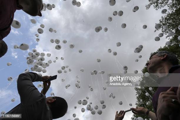 Members of WeAreTheLove release balloons into the sky to protest Assad Regime's airstrikes over Syria's Idlib and draw attention to civilians that...