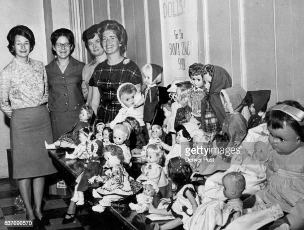 Members Of Wednesday YWives Display Dolls Soon To Be In Santa Shop They are left to right Mrs Alvin Krutsch Mrs Donald Bogart Mrs Robert Cline Mrs...