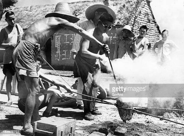 Members of Weising Commune smelting steel Rural China Late 1950s Great leap Forward Steel production drive