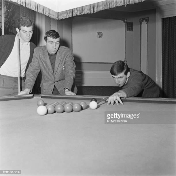 Members of West Ham United FC playing snooker at Eastbourne, UK, 11th February 1966. From left to right, Martin Britt, Peter Brabrook and Martin...